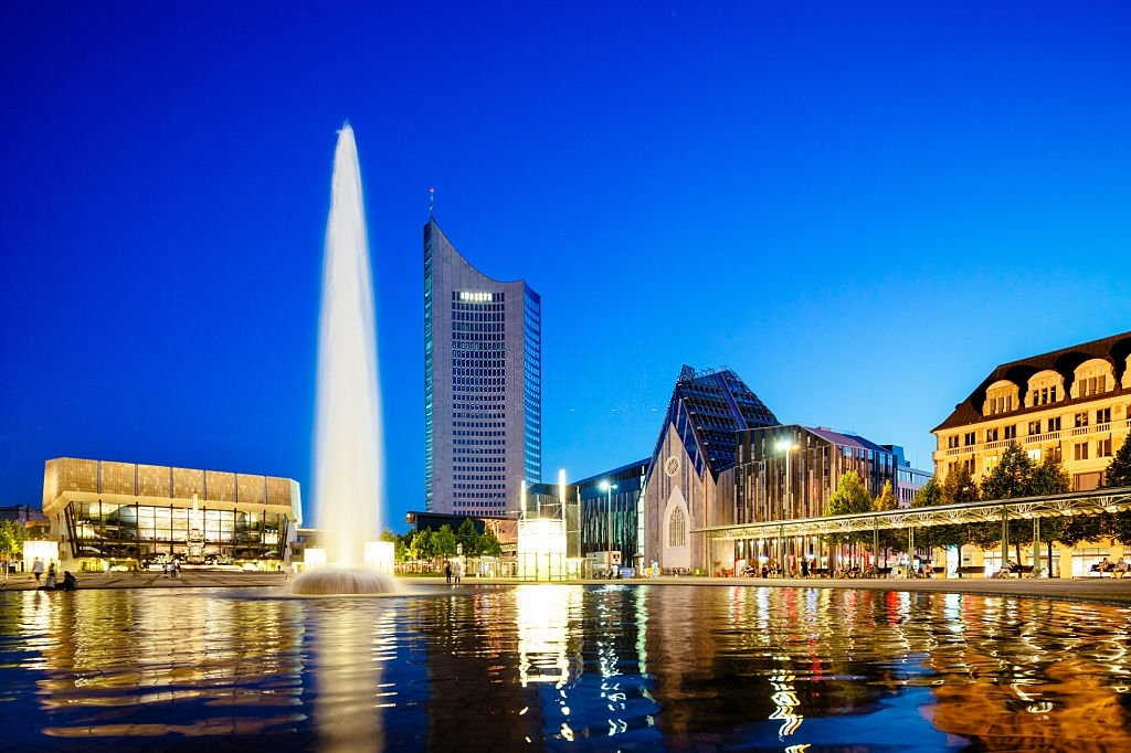 Gewandhaus concert hall with Mende fountain and the new university campus at Augustusplatz in Leipzig, Germany at night
