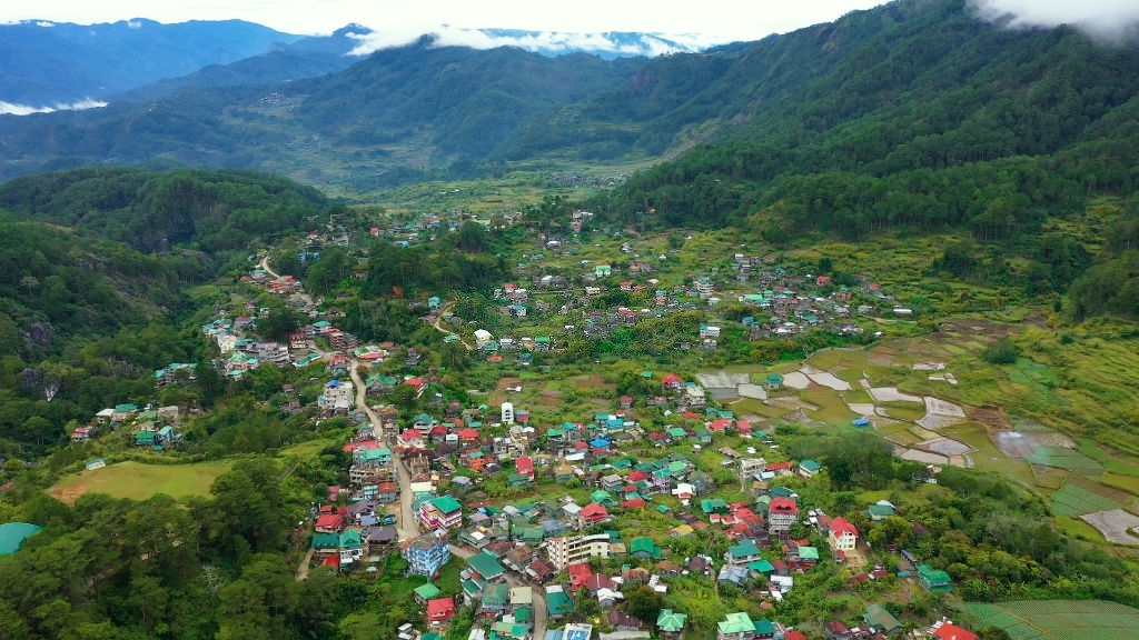 Typical houses of Sagada Mountain Province of the Philippines. The town is surrounded by mountains, a top view. Village in Cordillera mountains, Luzon, Philippines