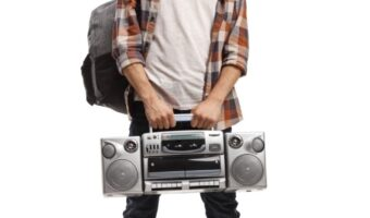 https://www.istockphoto.com/photo/male-teenager-holding-a-boombox-radio-gm1182617499-332149553